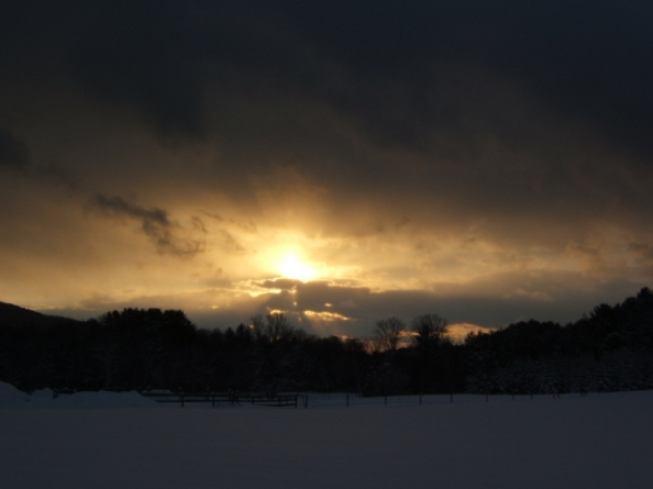 Sunset after Snowstorm over Holiday Field